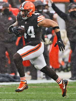 Cleveland Browns linebacker Sione Takitaki runs for a 50-yard interception return for a touchdown against the Philadelphia Eagles on Nov. 22 in Cleveland. Takitaki is one of five Browns players who will miss Sunday's game at Jacksonville because of COVID-19 testing. (AP Photo/Ron Schwane)
