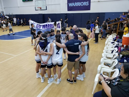 : The St. Paul Warriors huddle up after their victory