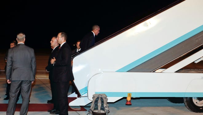 U.S. President Barack Obama climbs the stairs to board Air Force One at Hangzhou Xiaoshan International Airport in Hangzhou, in eastern China's Zhejiang province, Monday, Sept. 5, 2016, en route to Wattay International Airport in Vientiane, Laos. (AP Photo/Carolyn Kaster)