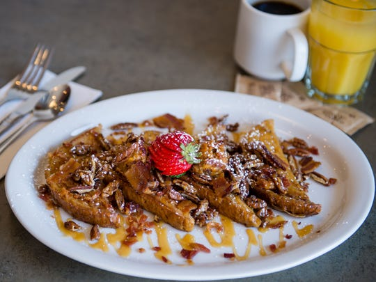 The OMG French toast at Turning Point is topped with pumpkin cinnamon mascarpone, toasted pecans, caramel drizzle and chopped Virginia smoked bacon.