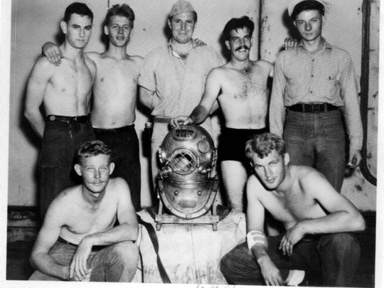 Ted Waller was a Boatswain's Mate 1st Class aboard the USS Portland from 1942 to 1945. He was a member of the ship's dive team. Here he has his hand on the US Navy Mark V dive helmet.