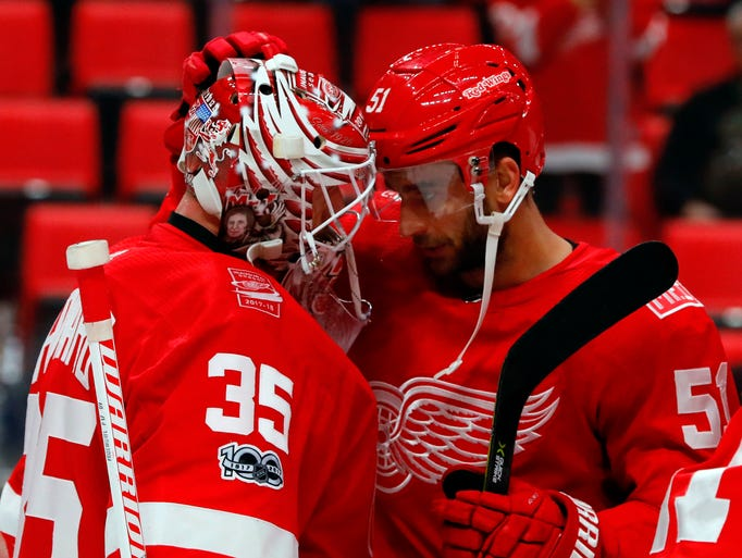 Red Wings goalie Jimmy Howard (35) and center Frans
