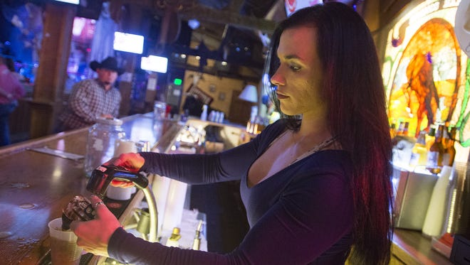 Jennifer Dean pours a pair of drinks at Sundance Steakhouse and Saloon on Tuesday, October 17, 2017. The dance hall has made changes, no longer allowing 18+ crowds on Tuesday nights.