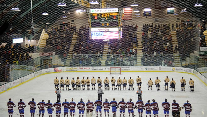 The teams listen to the National Anthem during the Vermont state Division I boys hockey championship game between Spaulding and Essex at Gutterson Fieldhouse on Monday evening March 19, 2018 in Burlington.