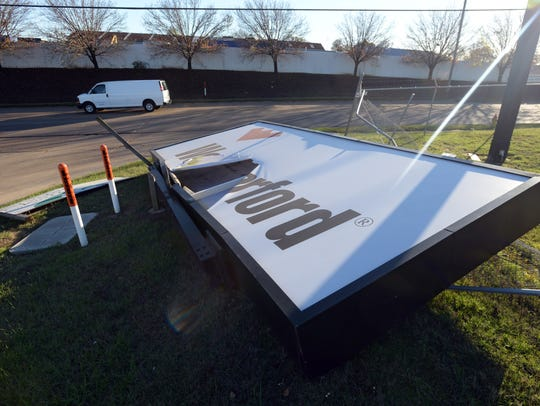 A Weatherford sign lays on it's side along Hollywood