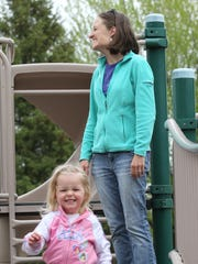 Liz Gosse and daughter MaeLynn Gosse, 2, play at Benedict Park in Marshfield.