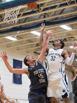 Penn State Mont Alto's Siele Johnson, guard, jumps up to block Billy Vaughn-Geib, of Penn State York, shot during a men's basketaball game in Mont Alto, Pa. on Saturday, Feb. 13, 2016. Penn State Mont Alto defeated Penn State York 69-55.