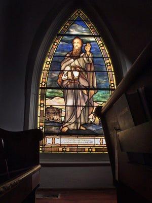 A window depicting St. Paul in Franklin, Tenn.