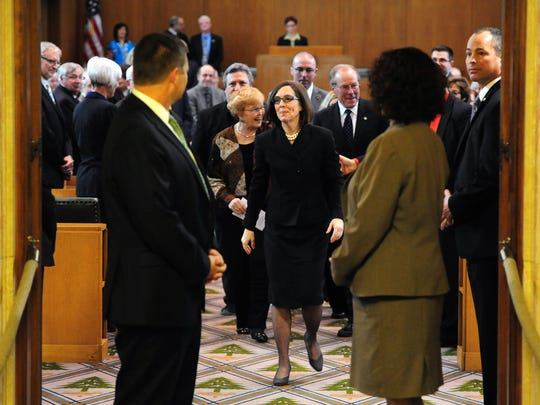 Oregon Gov. Kate Brown leaves the House of Representatives after being sworn in as the 38th Governor of Oregon at the state Capitol building on Wednesday