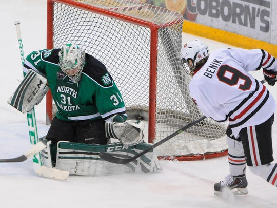 A shot by St. Cloud State's Joey Benik finds the back of the net behind North Dakota goaltender Zane Gothberg