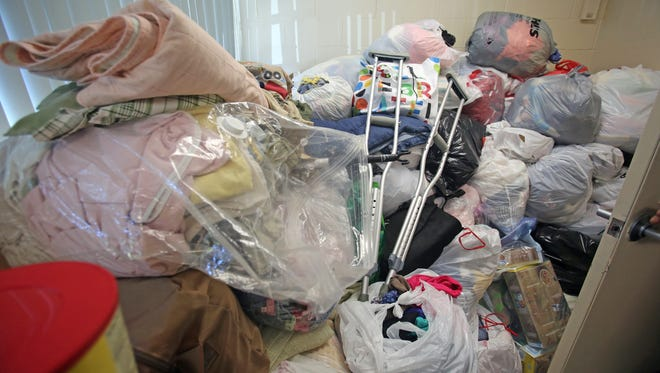 Clothes, food, diapers and medical supplies were donated to The Haitian Resource Center's Hurricane Matthew relief effort. Pictures here are piles waiting to be sorted at Slater Center in White Plains.