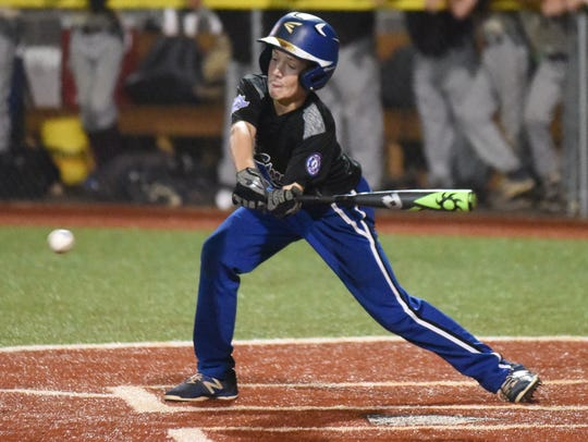 Mountain Home's Will Beckham swings at a pitch against