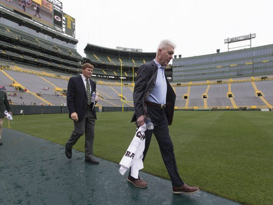 General manager Ted Thompson, right, and Mark Murphy,