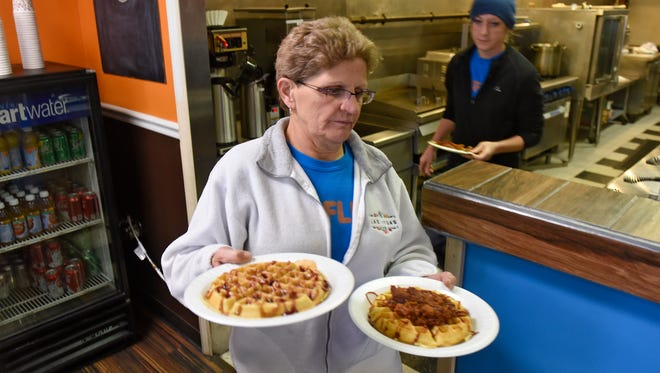 Fresh waffles are served at Waffle-It Wednesday, Dec. 7, in St. Cloud. The business features sweet and savory waffle combinations, freshly-made in house.