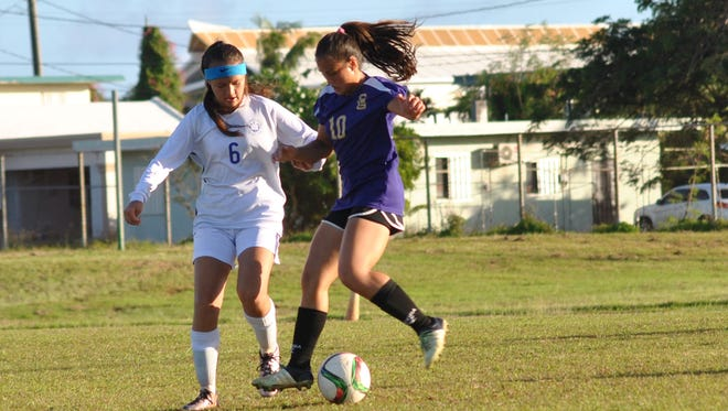 Notre Dame's Jenna Young and George Washington's Jalana Garcia fight for posession of the ball in the Independent Interscholastic Association of Guam Girls Soccer game on Saturday, April 29 at GW.