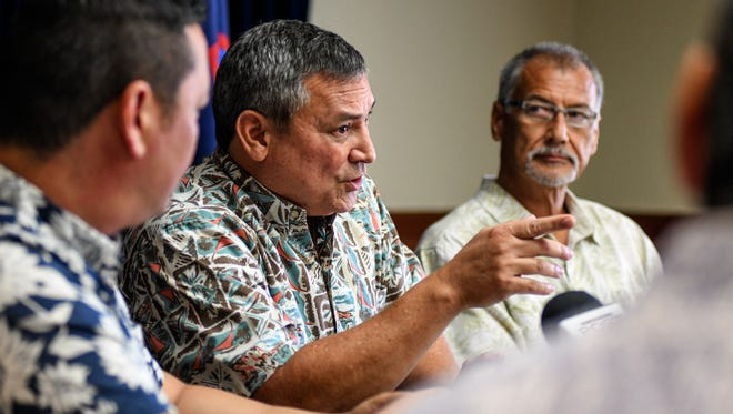 Gov. Eddie Calvo is flanked by members of his fiscal team as he provides an update on measures being considered to address the government's budget shortfall during a press conference at Adelup on Tuesday, Mar. 6, 2018.