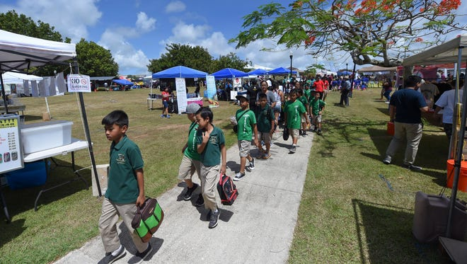 Children from schools islandwide attend the University of Guam's 49th Charter Day in Mangilao on March 14, 2017.