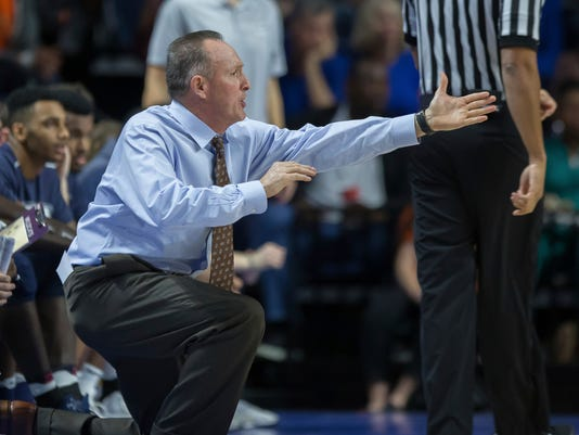 New Hampshire head coach Bill Herrion yells instructions to his team during the first half of an NCAA college basketball game against Florida in Gainesville, Fla., Sunday, Nov. 19, 2017. (AP Photo/Ron Irby)