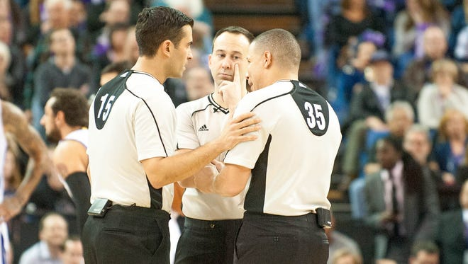 Jan 25, 2016; Sacramento, CA, USA; NBA officials Zach Zarba (15) and Kane Fitzgerald (5, middle) and Steve Anderson (35) discuss a call during double overtime in the game between the Sacramento Kings and Charlotte Hornets at Sleep Train Arena. The Charlotte Hornets defeated the Sacramento Kings 129-128 in double overtime. Mandatory Credit: Ed Szczepanski-USA TODAY Sports