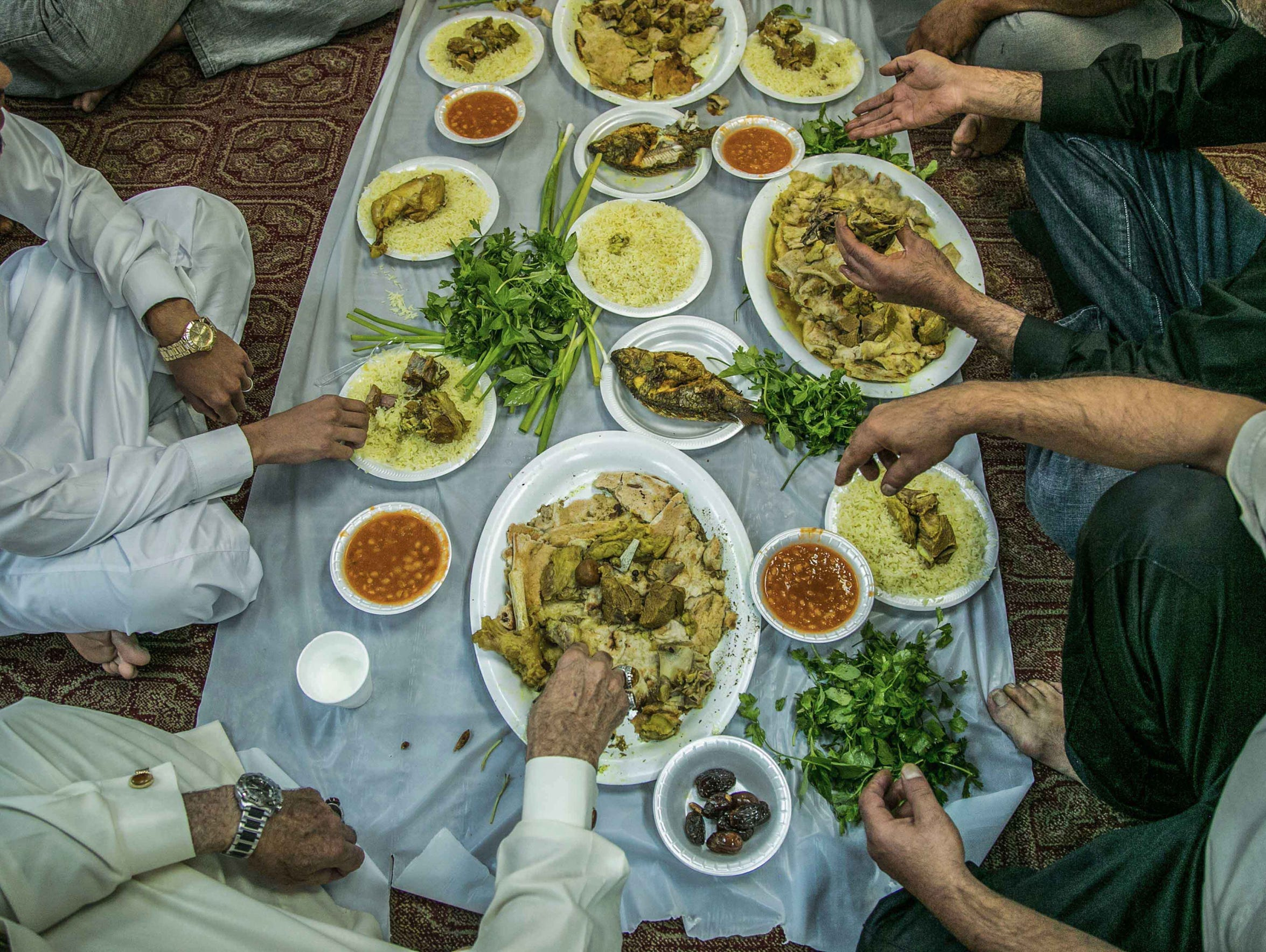 A traditional meal is held at Mokeeb Anssar Alhseen,