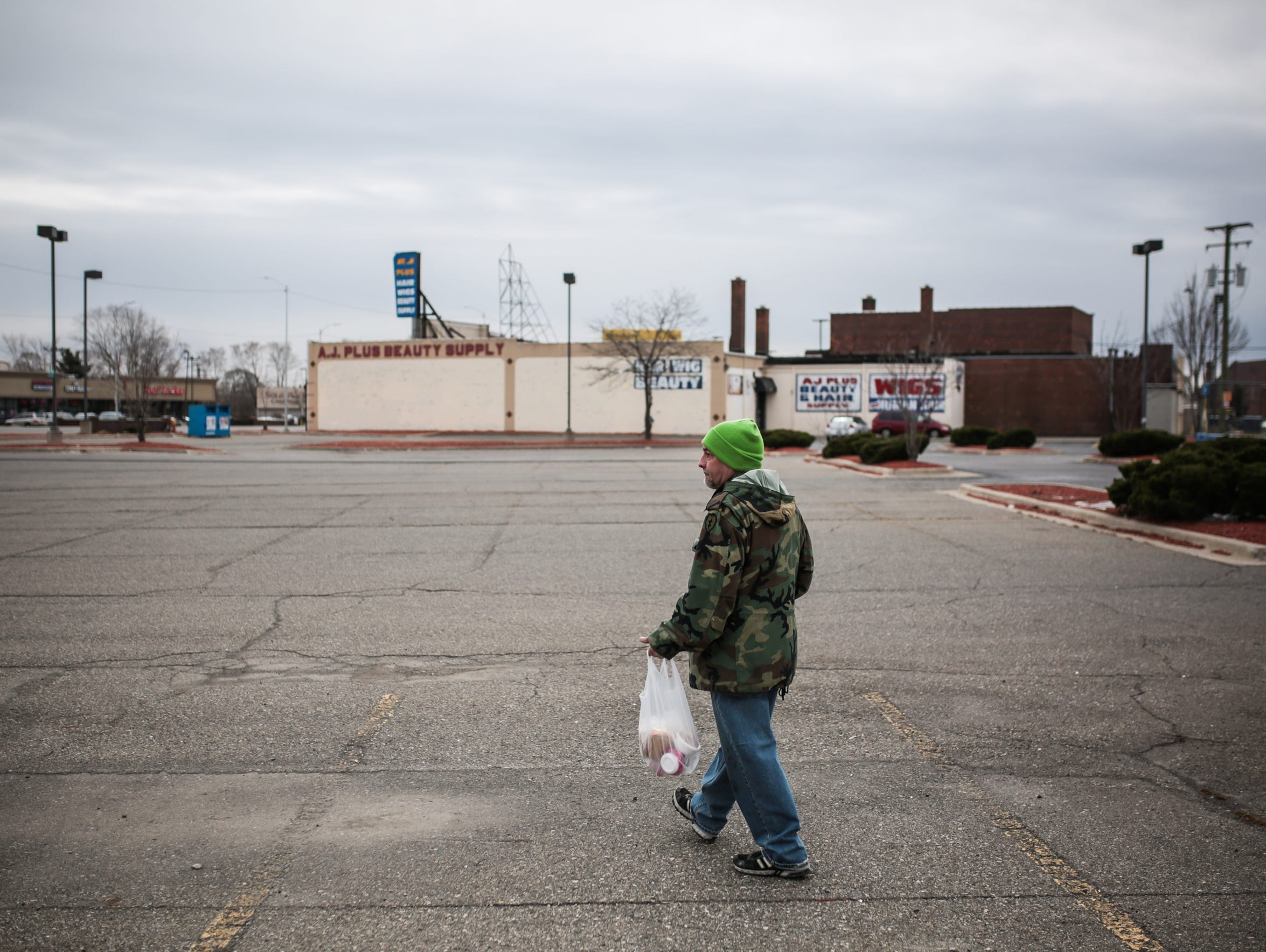 Michael Terrell, 58, of Detroit, walks home after getting
