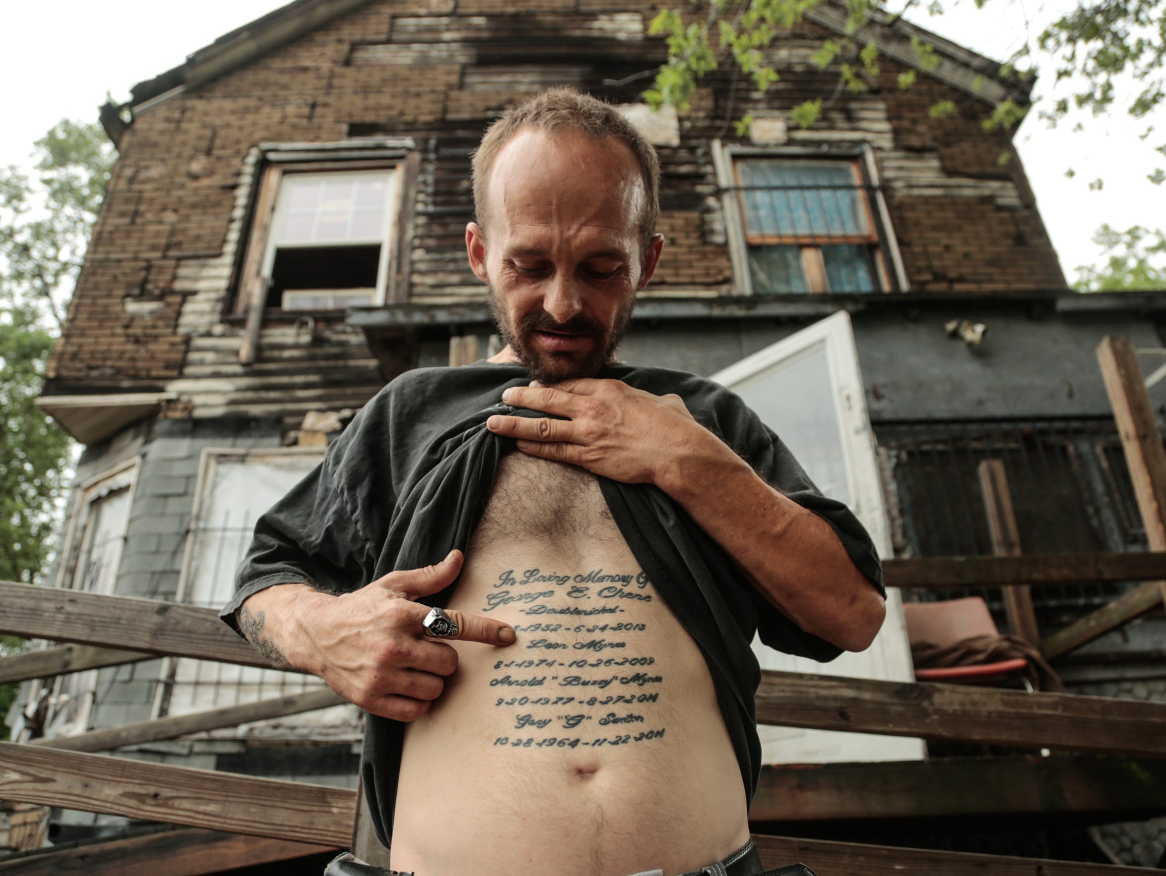 """Leon died from the swine flu,"" said George Chene, 39, of Detroit on July 12, 2017 while telling the story of the tattooed list on his stomach marking the birthdates and death dates of relatives and friends who once stayed in the house where he lived with his girlfriend and her daughter on Dragoon Street in Detroit's Delray neighborhood. Nearly all of those people died at the house."