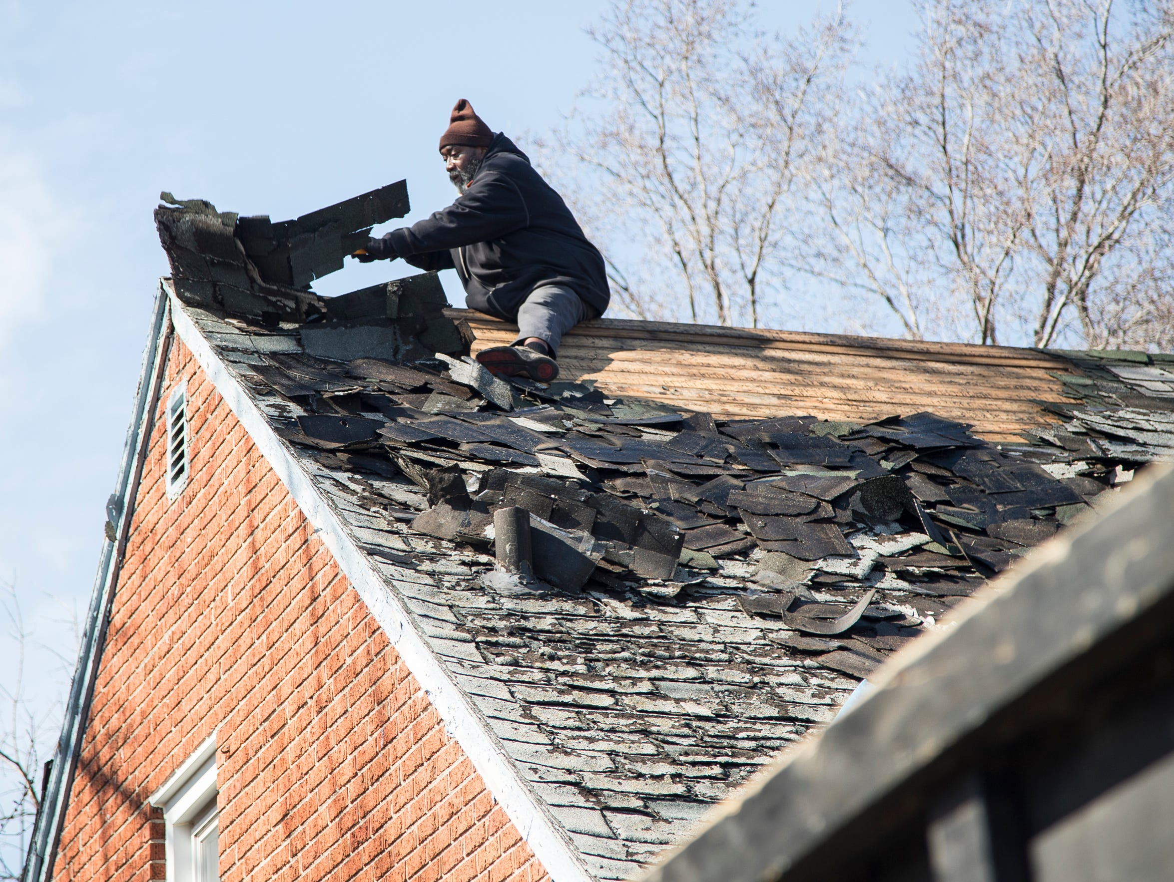 A worker is seen on the roof on St Marys Street north