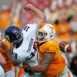 Tennessee defensive end Derek Barnett (9) causes a fumble as he sacks Northwestern quarterback Clayton Thorson (18) in the Outback Bowl on Jan. 1, 2016.