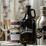 From left: A 32-ounce crowler from Point Ybel, the brewery's new standard 64-ounce growler, and its limited-edition stainless-steel beach growler.