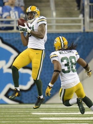 Green Bay Packers safety Ha Ha Clinton-Dix (21) makes and interception against the Detroit Lions in the first quarter during Sunday's game at Ford Field in Detroit. Evan Siegle/Press-Gazette Media/@PGevansiegle