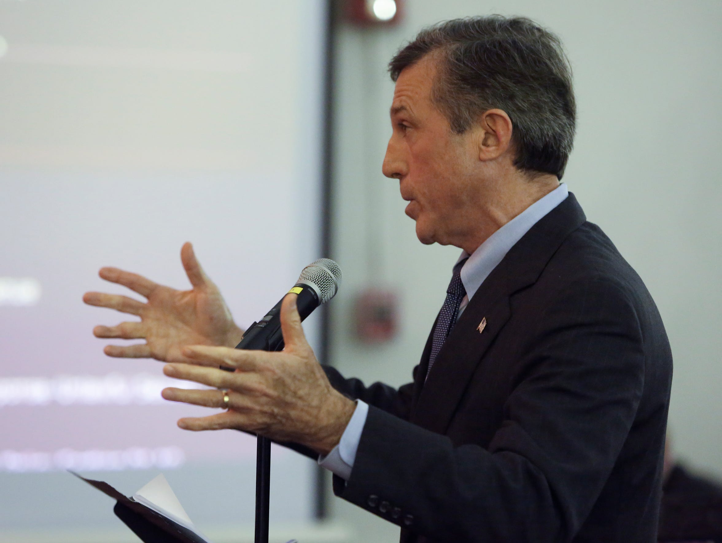 Gov. John Carney speaks in support of a plan to consolidate