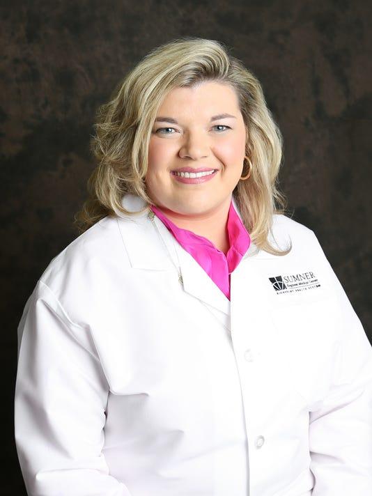 Dr. Tackett headshot.jpg
