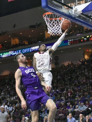 AJ Harris goes in for a easy layup against a Grand Canyon University's Matt Jackson on Saturday night.