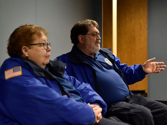 Mike Akers, right, discusses his experiences while working in the community as a member of the CPAAA.  His wife, Pat Akers, left, is also a CPAAA member.