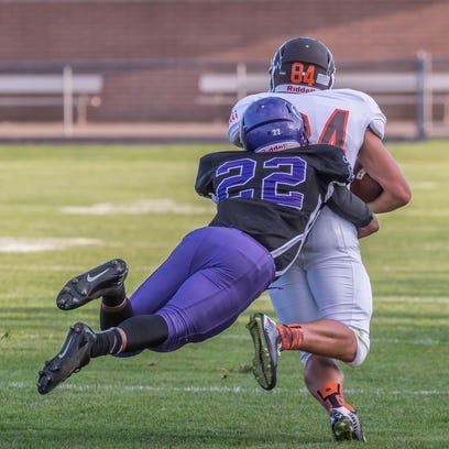 Lakeview's Caleb Edwards tackles a Portage Northern