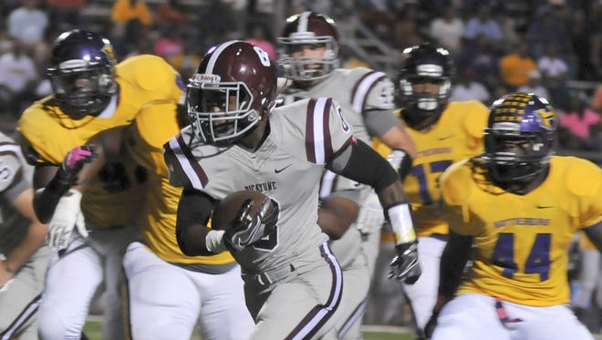 Picayune running back Josh Littles carries the ball against Hattiesburg Friday night in Picayune.