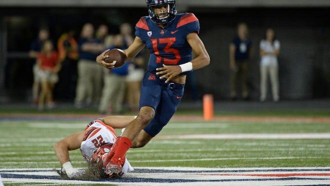 Former Arizona Wildcats quarterback Brandon Dawkins has tranferred to IU. He is a dual-threat quarterback, possibly more dangerous when running than passing.