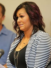"""Kristi Blevins, mother of James """"Austin"""" Hancock reads a statement June 6, 2016, before Judge Ronald Craft of Butler County Common Pleas Court's Juvenile Division before her son's sentencing in the shooting of two students and wounding two others at Madison Junior/Senior High School."""