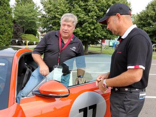 Rick Hughey of Watkins Glen climbs into a Jaguar F-TYPE
