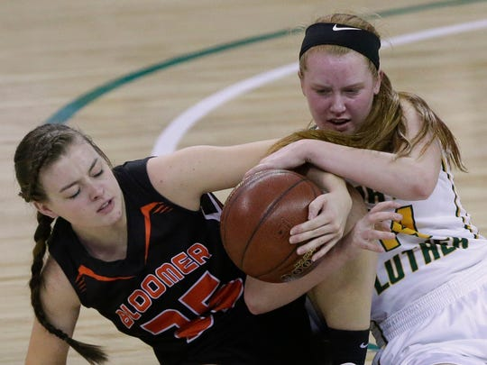 Bloomer's Danelle Score and Greendale Martin Luther's Bonnie Jensen compete for a loose ball.