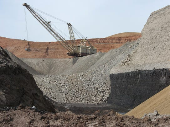 In this April 4, 2013, photo, a dragline excavator