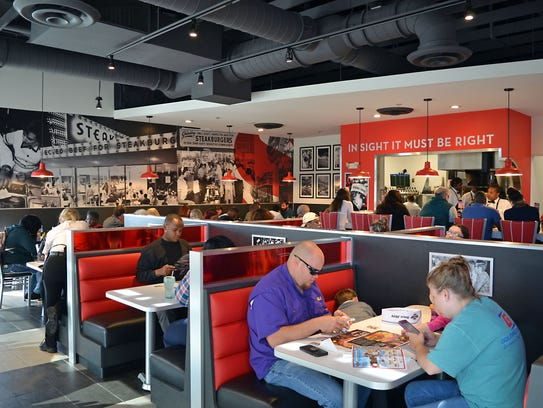 Steak 'n Shake customers enjoy their meal and the restaurant ambiance.