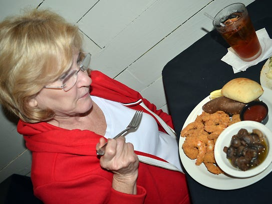 Pat Vanderberry, of Flowood, enjoys having dinner at