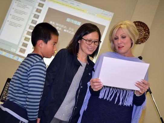 Carolyn Loftin, right, of Ridgeland reads the Completion