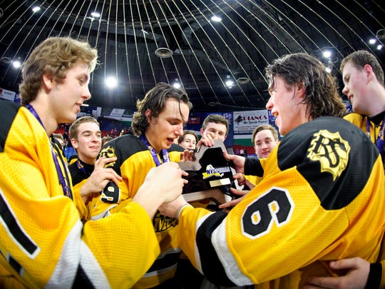 The McQuaid knights celebrates their Division I State Championship final Ice Hockey win against Baldwinsville at the Utica Memorial Auditorium on Sunday March 15, 2015 in Utica, NY. McQuaid won the match 6-2.