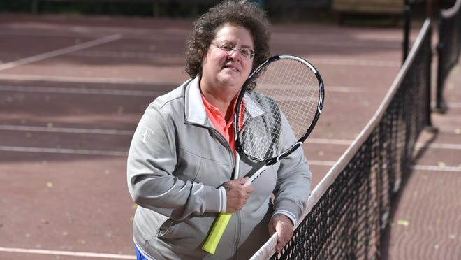 Abbe Seldin on the red clay courts of Oliver's Tennis Club where she regularly plays near her Wellfleet home. Former Supreme Court Justice Ruth Bader Ginsburg represented Seldin when she filed suit in the 1970s because she was not allowed to play on the boys tennis team at Teaneck High School in New Jersey.