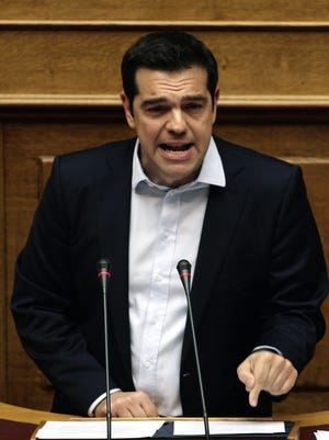 The risks of a Greek exit from the eurozone are growing, but economists say such an event is unlikely to damage the global economy. Greek Prime Minister Alexis Tsipras spoke during a televised debate Sunday.
