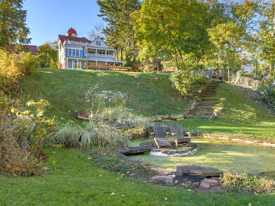 The backyard slopes directly to the Hudson River.