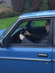 Joel Grey, 22, is shown driving to his new job - which