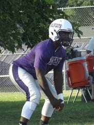 Green Bay West senior Anthony King goes through a defensive